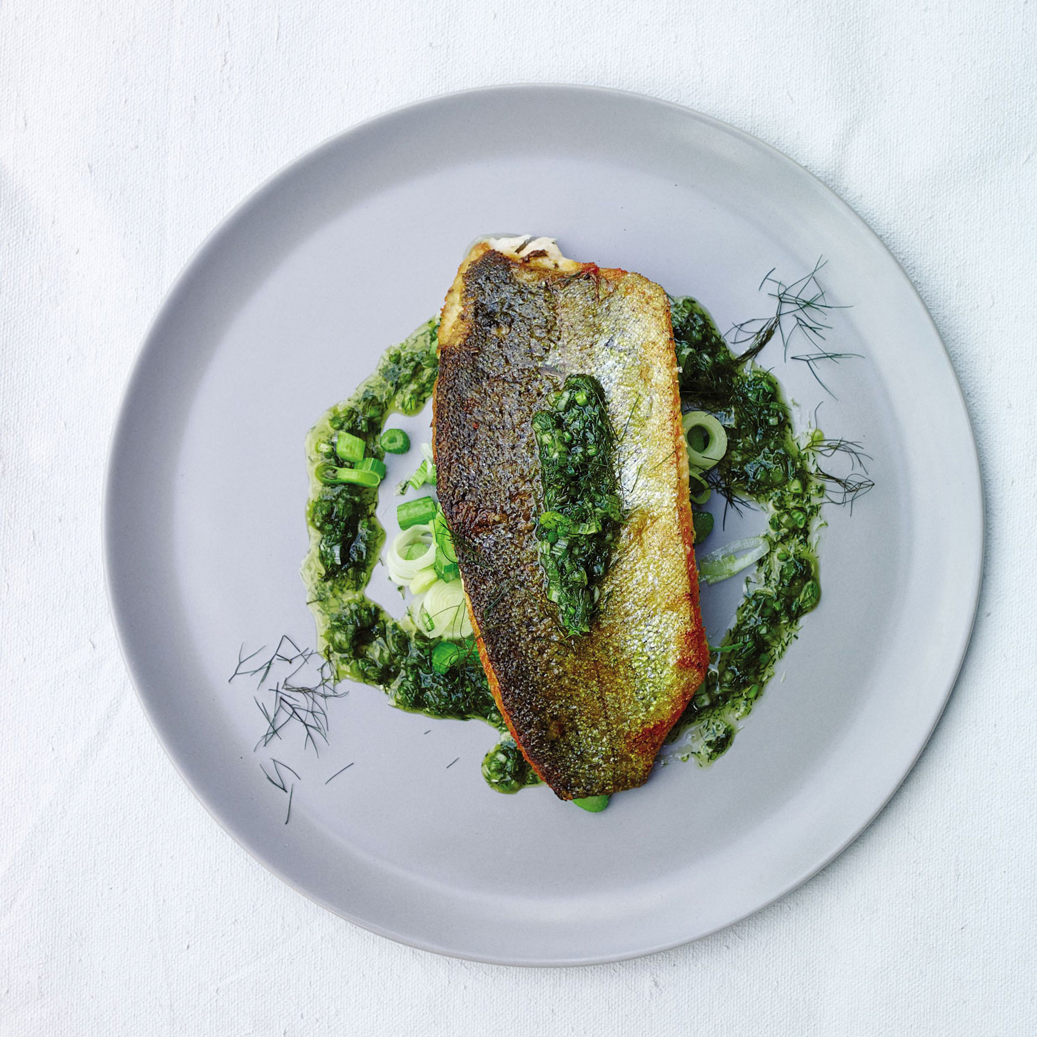"Trout fillets with sautéed fennel stems and fronds from ""Root to Leaf"" by Steven Satterfield. Photograph by John Kernick."