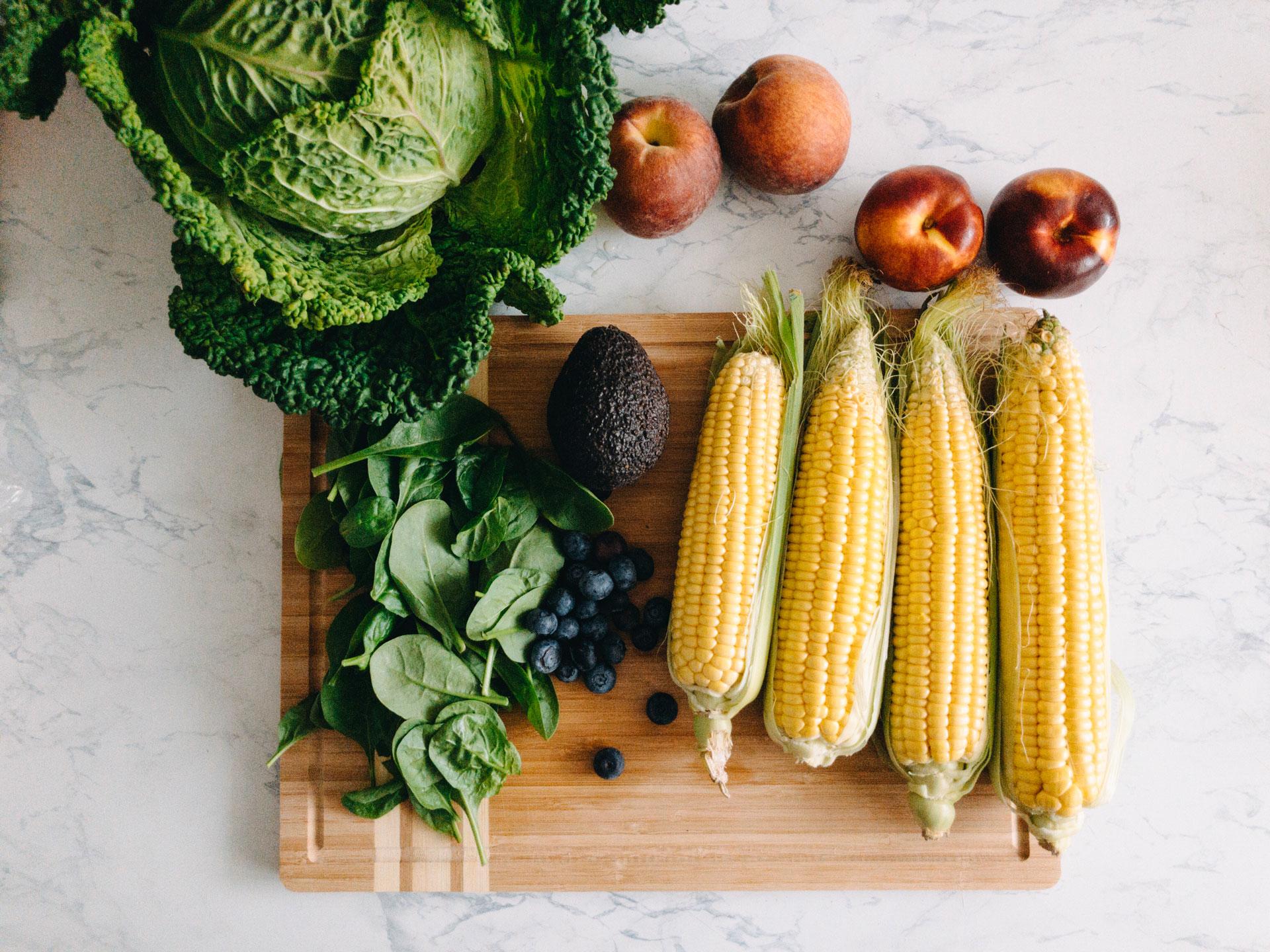 Fresh summer produce on cutting board