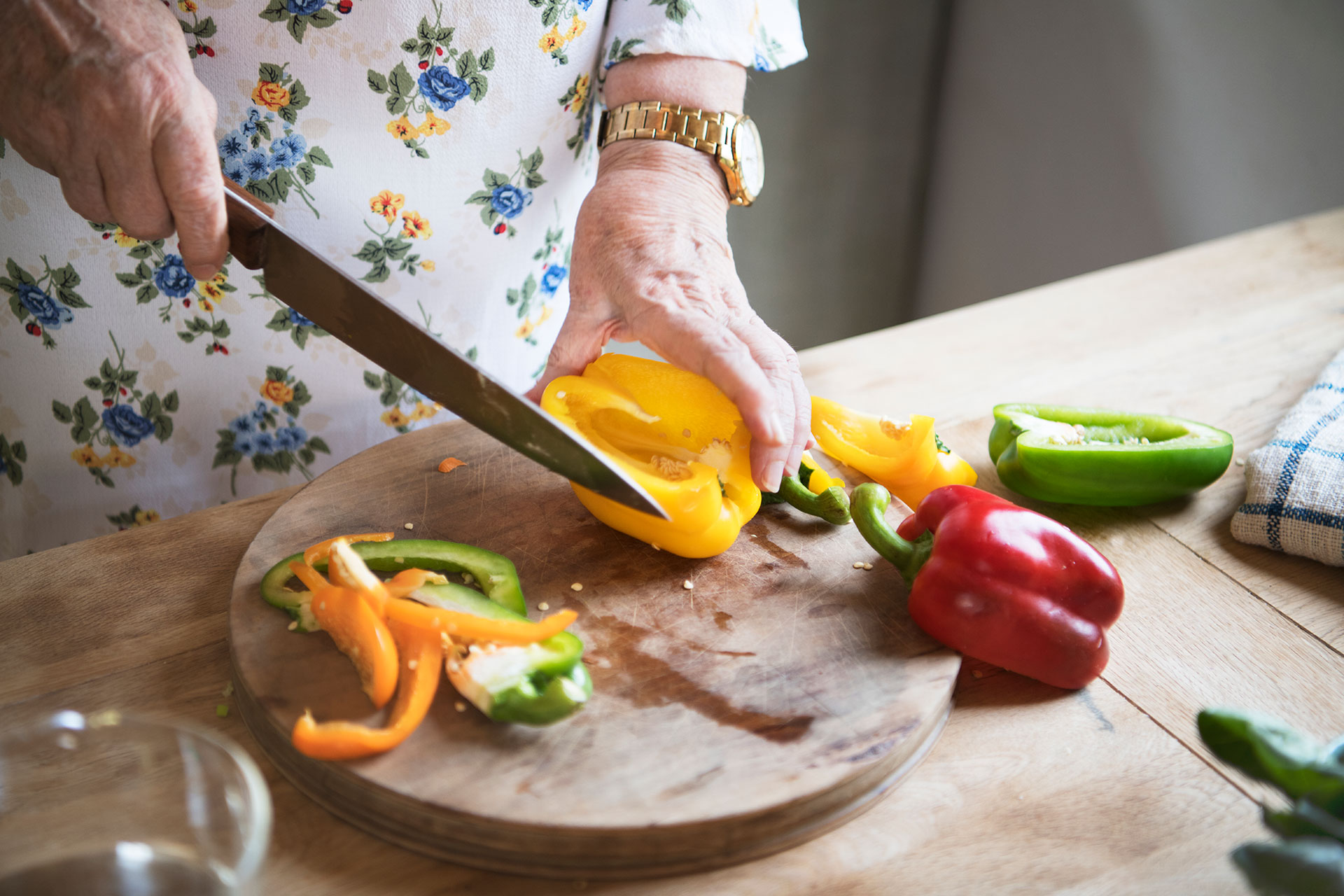 person chopping sweet peppers