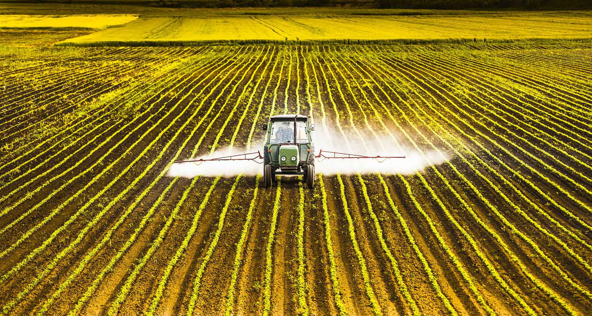 tractor spraying a field with glyphosate