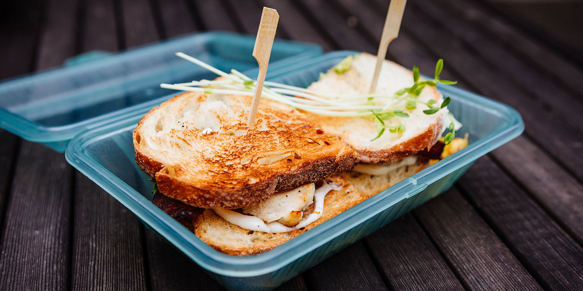 sandwich in a reusable takeout container
